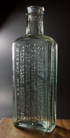 Sanford's Jamaica Ginger - aqua, rectangular, tooled square lip, 6 1/2in (165mm) tall. Embossing: SANFORD'S JAMAICA GINGER / THE QUINTESSANCE OF JAMAICA / GINGER, CHOICE AROMATICS & / FRENCH BRANDY, REGISTERED 1876 (back), POTTER DRUG & CHEM. CORP. (side), BOSTON, MASS. U.S.A. (other side) - 1885-1890. Old Medicine Bottles, Old Glass Bottles, Antique Bottles, Vintage Bottles, Bottles And Jars, Perfume Bottles, Blue Bottle, National Trust, Art Photography