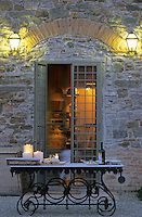 A table laid with pre dinner appetizers in the courtyard of this restored Tuscan farmhouse