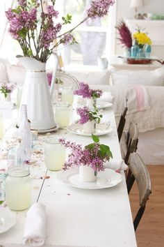 For a casual country chic style table design couple white dinnerware, candles and napkins with flowers in a white teacup that has your guests' initial on - makes a lovely party favour that they can keep to remember the evening by.