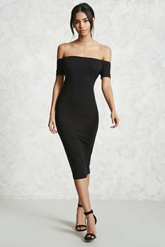 A ribbed knit bodycon dress featuring an elasticized off-the-shoulder neckline and short sleeves.