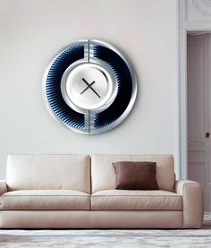 Artistic magic from the design genius of Jon Gilmore, the Omega Infinity Wall Clock will add a whimsical and futuristic twist to your living space. With infinity dimension and soft illumination, this art piece is both beautiful and functional.  #livingroom #artistic #magic #jongilmore #jongilmoredesigns #wallart #wall #clock #artdeco #homedesign #interiordesign #design #wallclock
