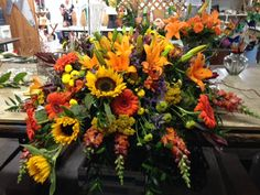 Half casket spray of fall colors ~ Padaro Floral