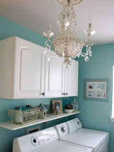 Laundry Room Ideas: Just because it's a laundry room it doesn't mean it can't have some glamour. A chandelier is unexpected and it elevates the style in the room.