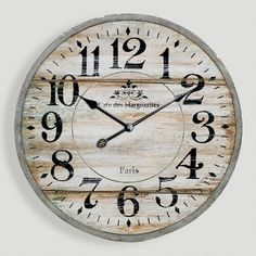 One of my favorite discoveries at WorldMarket.com: Norah Gray Wash Wood Clock