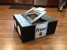 School project-Box Police Car, mark out color spaces and have kids paint. Black & White Day for color week. School Projects, Projects For Kids, Police Halloween Costumes, Car Costume, Cardboard Car, Community Helpers Preschool, Valentine Box, Dramatic Play, Police Cars