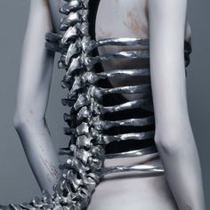 Spine Corset by Shaun Leane for Alexander McQueen, S/S 1998, photographed by Sølve Sundsbø