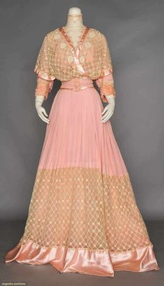 PINK SILK & LACE TEA GOWN, c. 1908. 2 piece, pink satin, bodice & wide hem band of cream lace, tulle high neck insert. Front