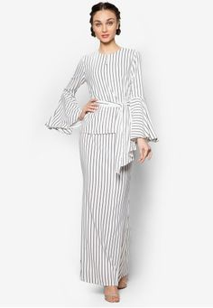 Pinstriped Pocket Kurung from Lubna in Black and White Lubna cultivates seamless charm through its use of clean lines and easy styling. Sophisticated without an effort, this monochrome piece aims to bless your image with a good dose of class.  Top - Polyblend - Round neckline - Long sleeves - Hook an... #bajukurung #bajukurungmoden Ethnic Fashion, Hijab Fashion, Fashion Dresses, Womens Fashion, Kebaya Dress, Batik Dress, Dress Images, Monochrom, Designer Dresses