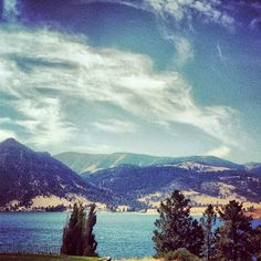 Big Sky Country - Montana. Such beautiful skies, mountain range, & water. Picture perfect outdoor scene.
