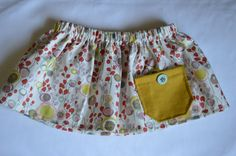 Pastel patterned fabric skirt with a mustard pocket on Etsy, $18.00