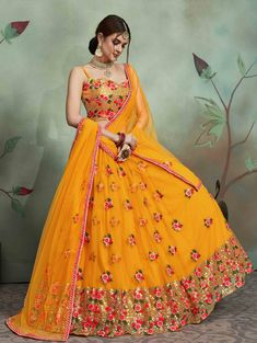 It is full length lehenga.The Material is shiny yellow and the net is dark yellow which gives wonderful contrast. #embroidery #lehenga Wedding Lehenga Designs, Designer Bridal Lehenga, Bridal Lehenga Choli, Indian Lehenga, Indian Gowns, Net Lehenga, Wedding Lehnga, Lehenga Kurta, Lehenga Designs Latest