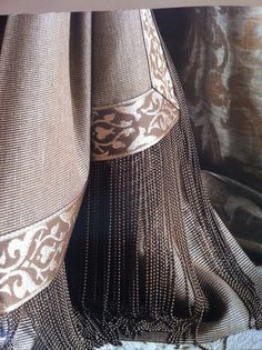 Puddled curtains & details in lovely palette. Love this amazing detail!