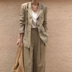 linen blazer and pleated trousers.