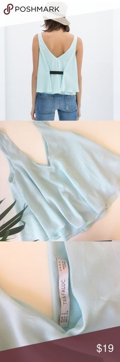 """Zara ribbon back tank top Beautiful baby blue tank top with ribbon details on the back. Bust:17.5"""" length:20"""" approx. feel free to ask me any questions!  Check out my closet and bundle for 20% discount!! I'm always talking reasonable offers!! Zara Tops Tank Tops"""