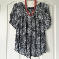Black and white top Black and white design top. Round neckline but not a crew neck. Short sleeves with elastic to create a little puckering. Fabric listed in picture 3. The fabric is sheer like but not see through. Back is shown in picture 4. Apt. 9 Tops Blouses