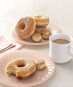 Homemade doughnuts with Grands Pillsbury biscuits from Real Simple~My dad used to make these when I was growing up and now I make them for my fam!  The best is dipping them in chocolate syrup or powdered sugar!