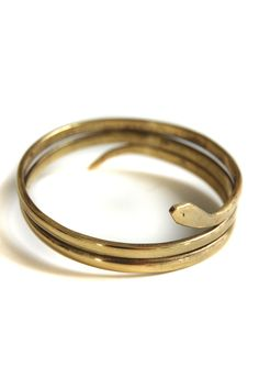 brass coil snake bracelet handcrafted by artisans in Kenya (plus a portion of every sale is donated to A Voice is Heard)