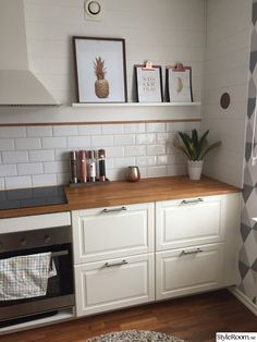 See the nice white subway tiles...I like! and the cool picture rail idea...might not have room for this in our house, but maybe yours nest to fridge or??? This is the Bodbyn Ikea range...very traditional looking, but might work in our house...