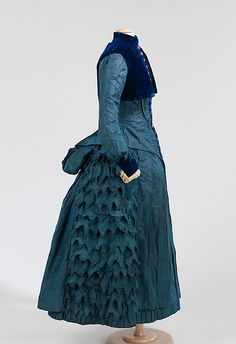 Dress Date: ca. 1885 Culture: American Medium: silk, cotton This high style dress made for a girl of about 8-10 years of age is an exact copy of women's clothing, including the bustle silhouette.