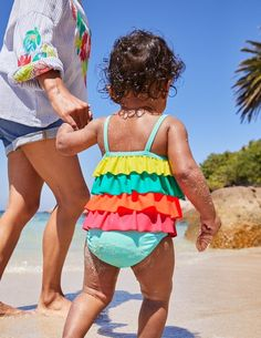 Layer upon layer of ruffle will delight your little one both in and out of the water. The fabric is lined and provides handy UPF 50 where it covers the skin, while the elasticated design means baby will be ready for the pool in a flash. Choose from floral or ra-ra rainbow designs for a day out in the sunshine –don't be surprised if you get a touch of frill envy.