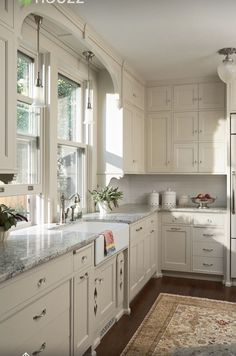 Cream Kitchen Cabinets, Gray Granite Countertops, Dark Wood Floors, Black  And White Cow Hide Area Rug    Kitchen Cabinet Paint Color Benjamin Moore  OC  14 ...