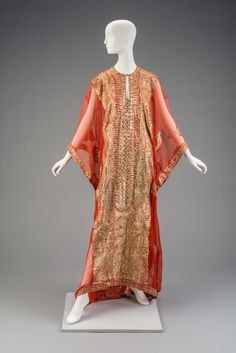 Museum of Fine Arts, Boston  Thobe nashil, Saudi Arabia  Sheer orange thawb with gold embroidery and gold sequins in leaf designs. Side openings for arms. Button and loop at top of neck opening. Collarless, with slit front opening at neck.