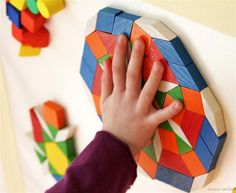 tactile blocks of wood or foam stuck to contact paper for temporary mosaic- could also put magnet paint on a door /shelf and do this with magnet pattern blocks