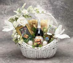 The Wedding Wishes gift basket conveys your best wishes with elegance. This gift features sparkling apple cider and two champagne glasses, a picture frame, candles, and gourmet snacks for two. The lovely white basket is decorated with white flowers and white love birds. $84.99