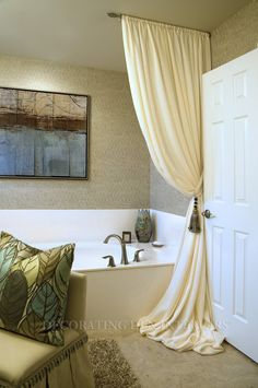 Like this half curtain rod mounted on the ceiling and the beautiful puddled drape. A very chic and elegant bathroom!!!