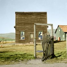 Dorothea Lange Color Farmer saloon and stagecoach tavern which is the temporary home of a member of the Ola self help sawmill co-op. Gem County, Idaho. Published - October 1939 Colorized Dust bowl migration