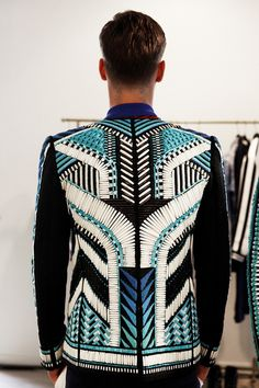 Beaded jacket in geometric tribal pattern. Backstage at Balmain Spring / Summer 2015, Menswear. Photo: Marie-Amélie Tondu http://www.dazeddigital.com/fashion/gallery/18084/5/balmain-ss15