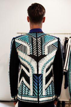 Beaded jacket in geometric tribal pattern. Backstage at Balmain Spring 2015, Menswear. Photo: Marie-Amélie Tondu http://www.dazeddigital.com/fashion/gallery/18084/5/balmain-ss15