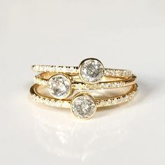 A stack of our Layla Rings set with salt & pepper diamonds and white diamond…