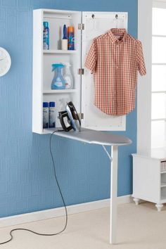 Wall mount ironing center. Very practical.