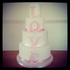 4 tier love wedding cake pink and white