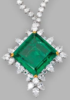 Platinum, 18 Karat Gold, Emerald and Diamond Pendant-Brooch/Necklace Combination. The pendant set with a square emerald-cut emerald weighing 49.21 carats, framed by pear-shaped and round diamonds weighing approximately 13.50 carats, suspended from a necklace half set with round diamonds weighing approximately 16.25 carats, and half set with pear-shaped diamonds weighing approximately 18.00 carats.