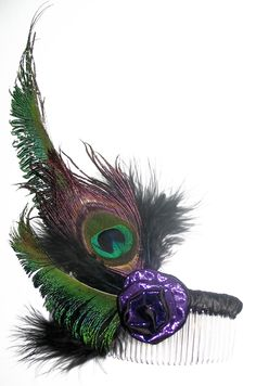 Peacock feather fascinator - http://www.peacockfancy.co.uk/userimages/Fascinators--PeacockFeather-2(1488287).htm