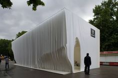 """Architects Olga Sanina and Marcelo Dantas won the international competition for the design of the Pavilion of the Ayuntamento de Madrid with a proposal titled """"La Casa de Librio"""" (The Book House), built for this year's edition of the Madrid Book Fair.  Walking through pages-such were the words used by blogger Judit Bellostes to describe this object, like a book built with pages, vertical sections used to generate an internal cavity of organic topography."""