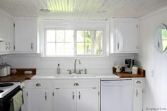 reclaimed wood counters white cabinets porcelain sink white glossed ceiling *WANT!*