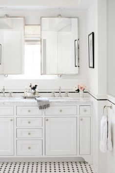 Bathroom Decor countertop This chic all white bathroom has marble countertops, white vanity cabinets, dual sinks, and double vanity mirrors. Coastal Bathrooms, Upstairs Bathrooms, Chic Bathrooms, Master Bathrooms, All White Bathroom, Small Bathroom, Classic Bathroom, Bad Inspiration, Bathroom Inspiration