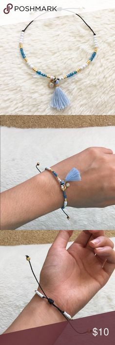 Blue Tassel Seed Bead Bracelet Seed beads, tassel made with thread, with jewel charm, nickel free, adjustable, on waxed cording. Fits around a 6-10 inch wrist. NOT pura vida, handmade by me (: Pura Vida Jewelry Bracelets