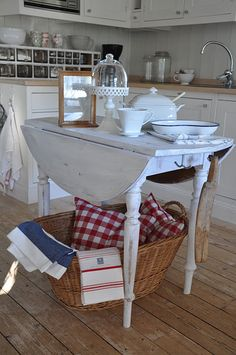 I would like this table for an island andlike the splash of red checks there....