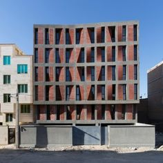 Perforated+brick+screens+act+as+curtains+for+Tehran+housing+by+CAAT+Studio