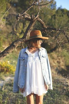 Big jean jacket with white dress and floppy hat