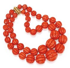 Jayne Wrightsman ,Coral Bead Necklace, Verdura , $53,125.00 ,double-strand necklace composed of 44 fluted coral beads graduating in size from approximately 25.0 to 10.0 mm, completed by an 18 karat gold beadwork clasp.