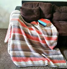 I loved the look of the River Rock Slouch and Scarf, that I wanted to see how it would look as a blanket. This is an easily adjustable d...