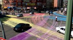 Guerrilla intervention in Berlin; pigments thrown into an intersection produce real time traffic mapping and/or large scale urban drawing