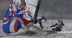Great Britain's competitors in the 49er FX sailing class Charlotte Dobson and Sophie Ainsworth sail during a training session on Rio de Janerio's Guanabara Bay for the 2016 Rio Olympic Games, on August 7, 2016. / AFP / WILLIAM WEST