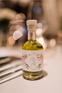 Extra virgin olive oil with a customized label for wedding guest favours. Weddings in Crete, Greece by www.creteforlove.com