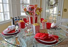 This movie themed table setting would definitely work for an Oscars themed party.  I love the red and white candy filled centerpeice! #CouchCritics